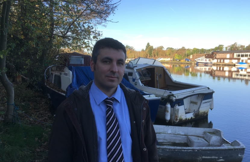 Cllr Bax views river wrecks and slum boats