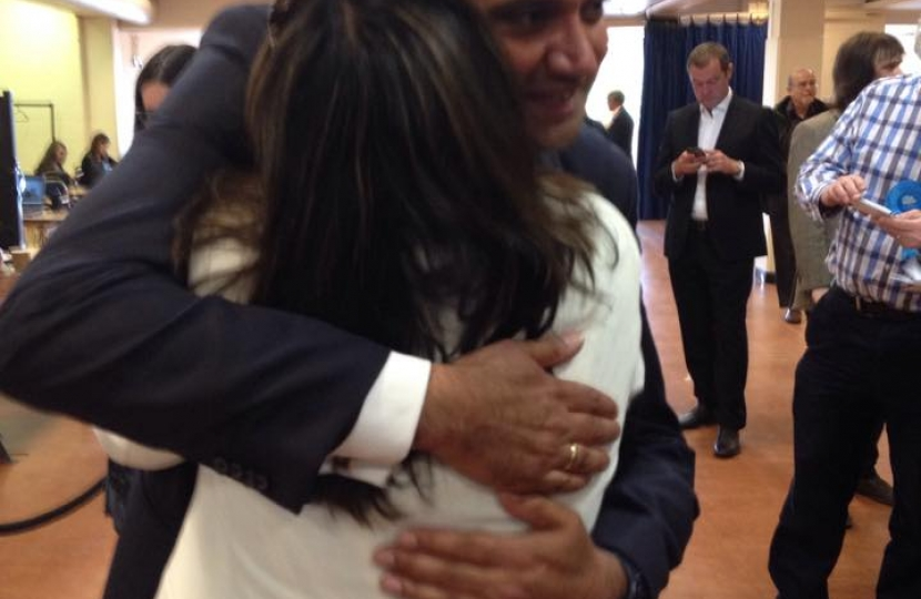 Manwinder Toor hugs his wife after winning St George's Hill by just 26 votes.